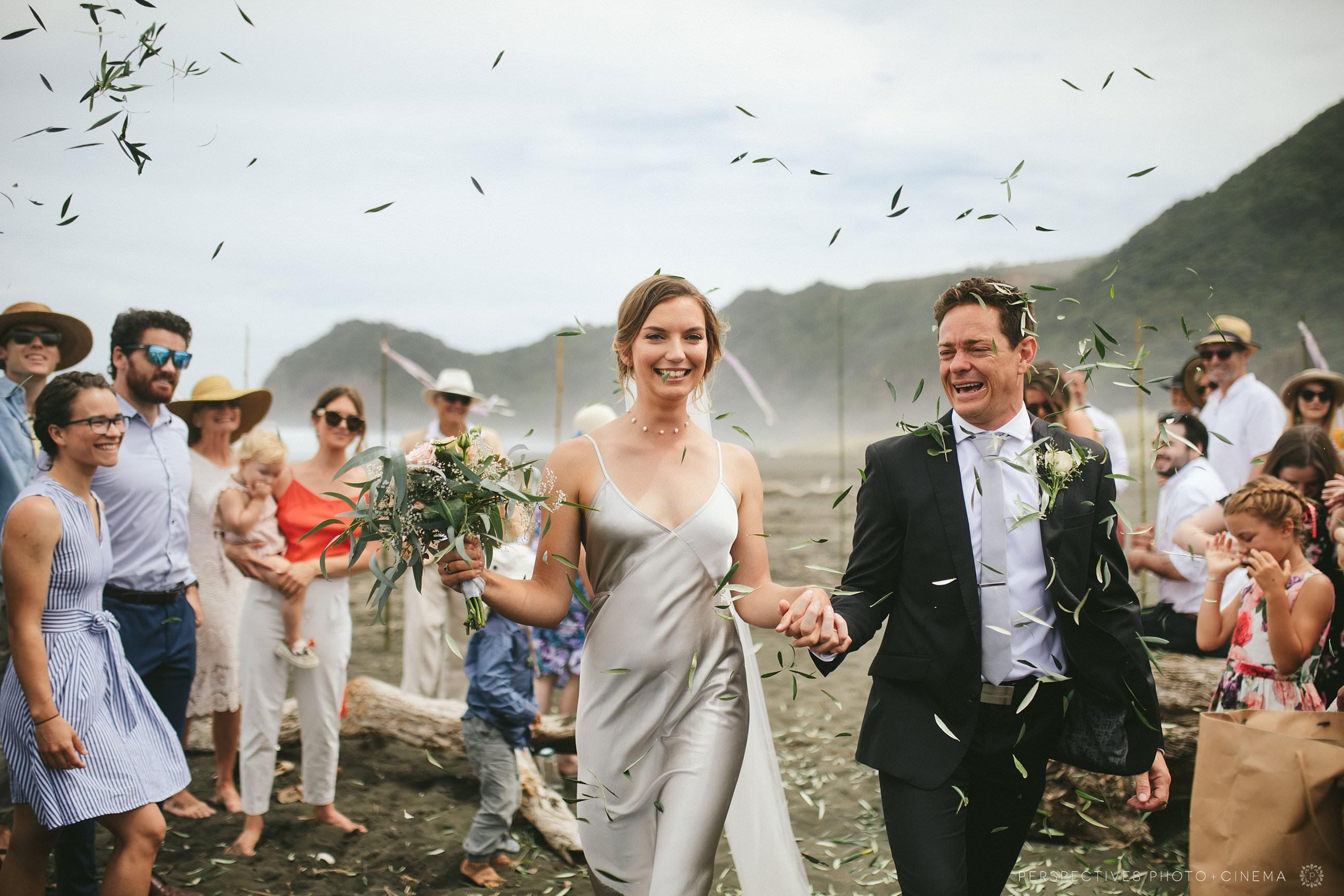 Piha beach Auckland wedding photos ceremony on beach