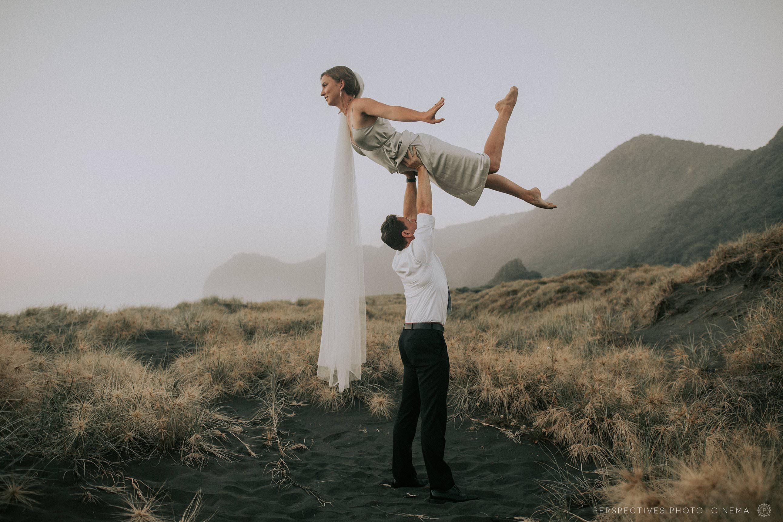 Circus acrobatics wedding photos Piha beach Auckland wedding