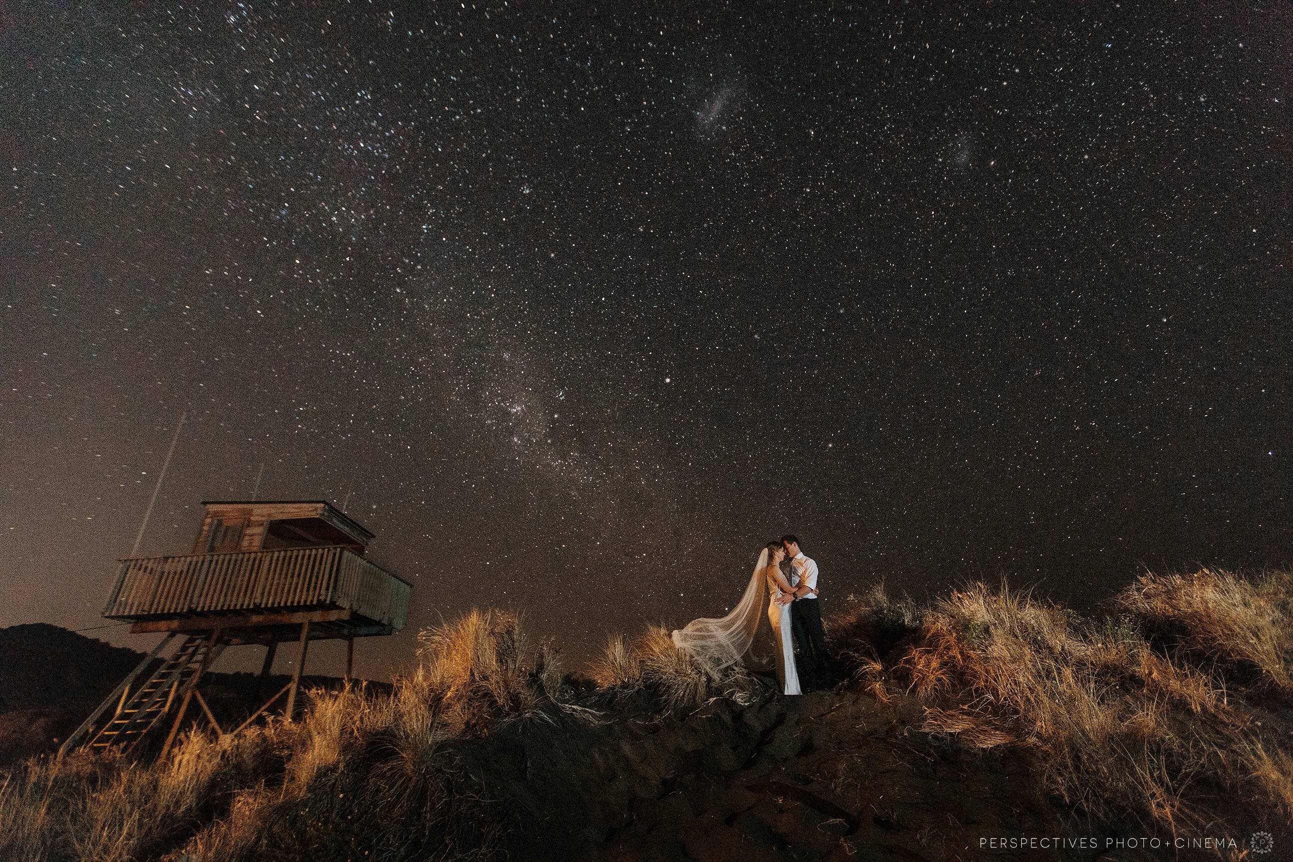 Star wedding photo Piha Barnett Hall under the stars
