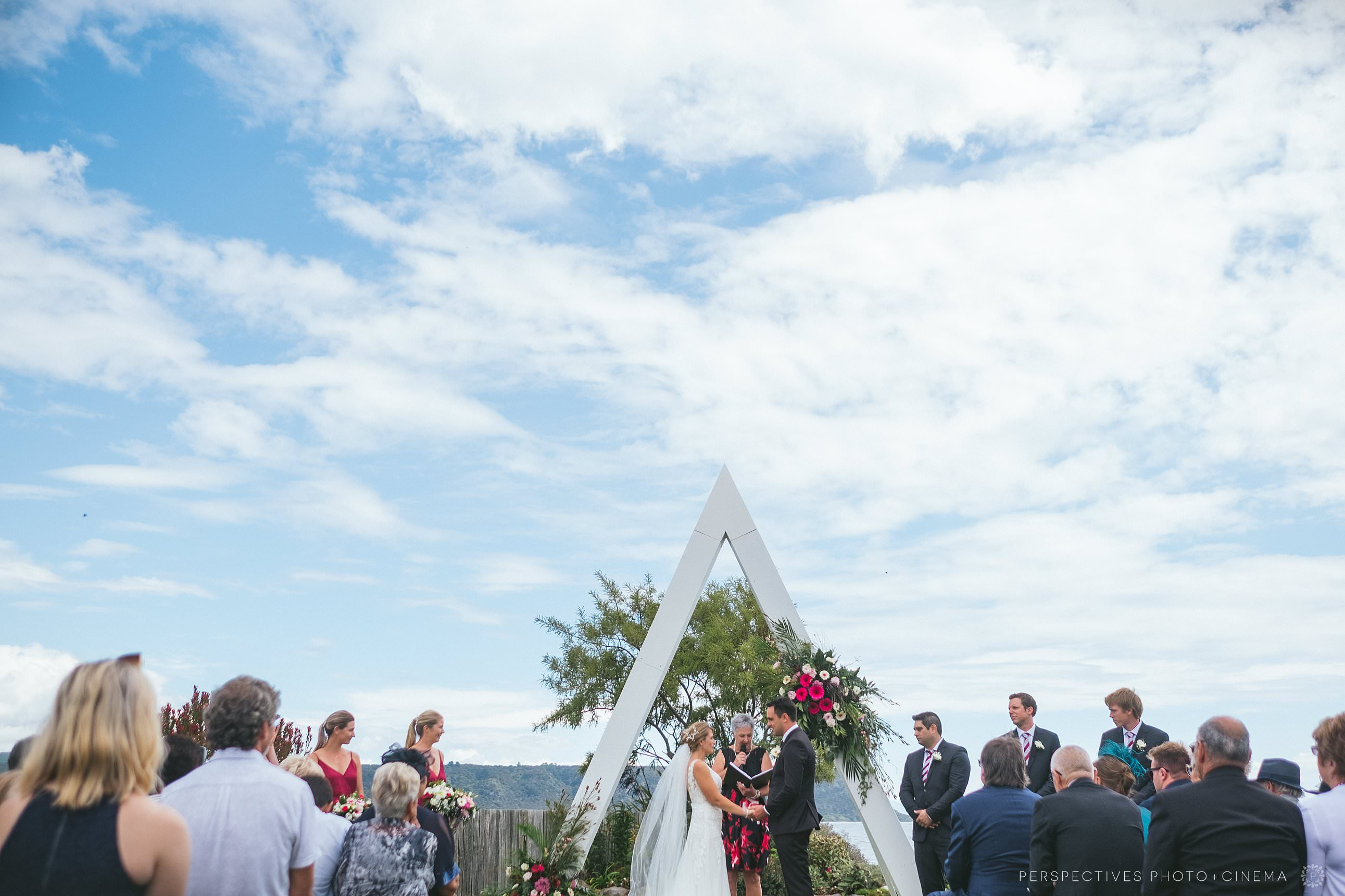 Taupo wedding photographer - ceremony with arch
