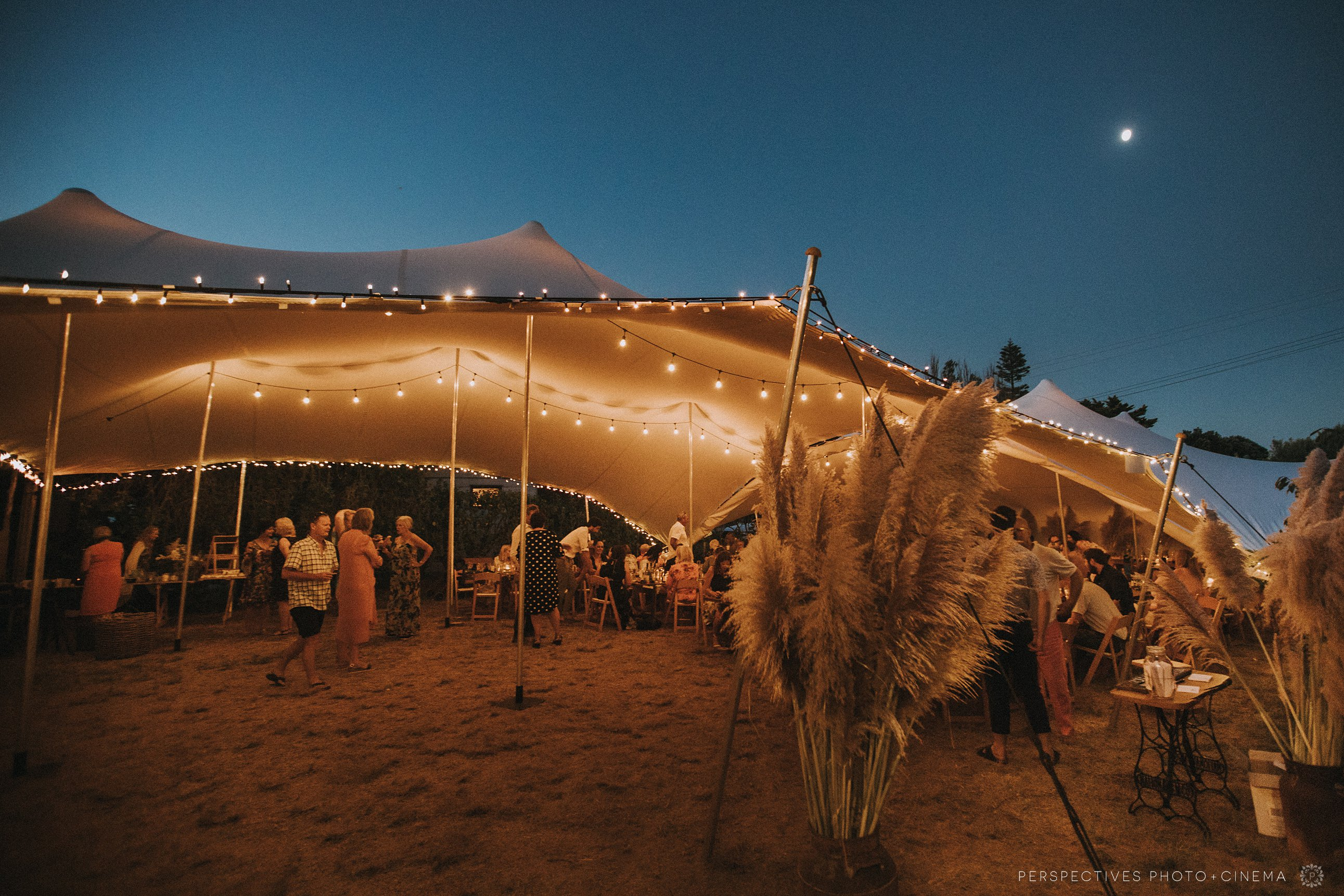 Marquee wedding setup DIY rustic boho styling Coromandel New Zealand