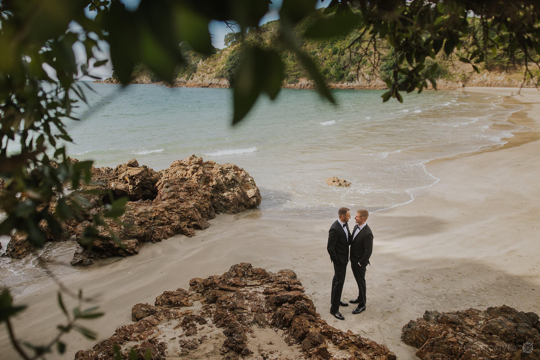 Waiheke Tantalus estate beach wedding photos two grooms