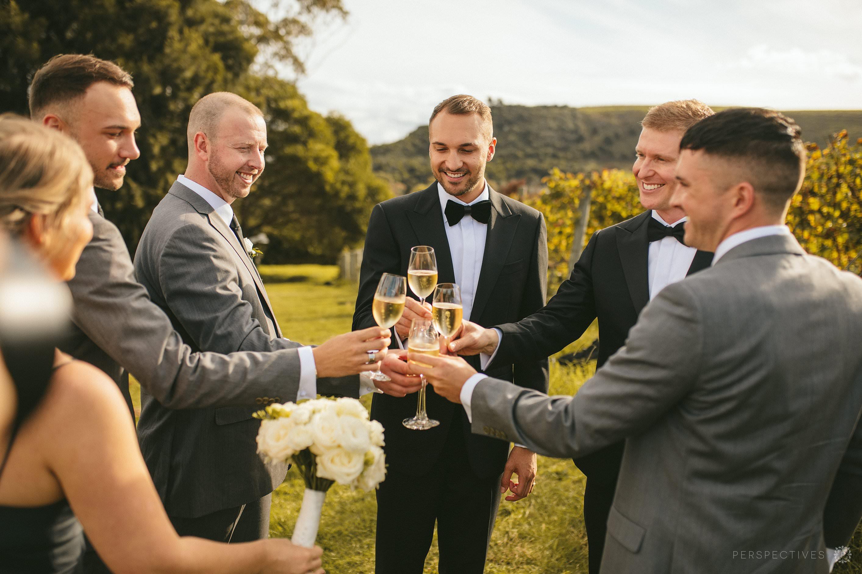 Champagne in the vines at Tantalus Estate Waiheke wedding venue