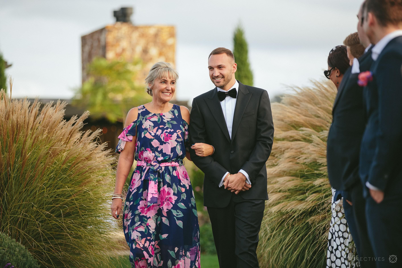 Tantalus Waiheke wedding venue ceremony on lawn